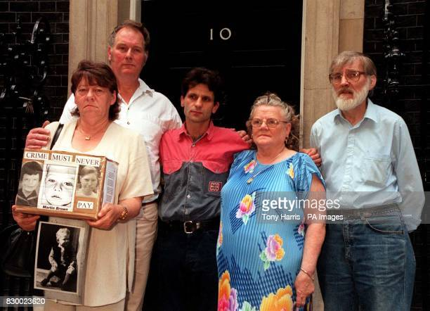 Relatives of murdered children in Downing Street today where they delivered a 25000 signature petition protesting over murderer Mary Bell being paid...