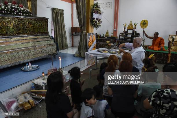 Relatives of Natalie the 11month old girl whose death was broadcast live on Facebook receive blessings from a Buddhist nun in front of Natalie's...