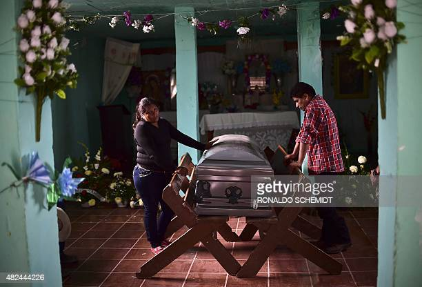 Relatives of one of the victims of the truck accident cry next to its coffin in Santa Rosa town in Zacatecas State on July 30 2015 A truck plowed...