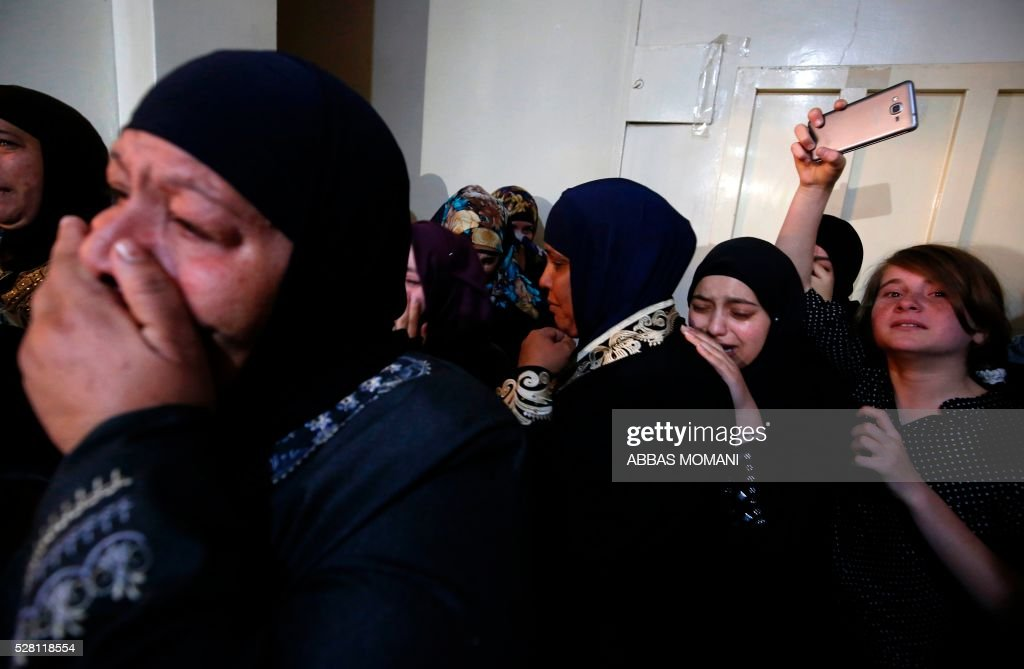 Relatives of Palestinian Ahmed Shahaada, 36, who was shot dead by Israeli troops after ramming his vehicle into three Israeli soldiers in the occupied West Bank, mourn during his funeral in Betunia, near the city of Ramallah, on May 4, 2016. A Palestinian rammed his car into a group of Israeli soldiers in the occupied West Bank on May 3, injuring three before being shot dead, the Israeli army said. The army later confirmed that the injured were soldiers, and said they were taken to hospital for treatment without giving further details. MOMANI