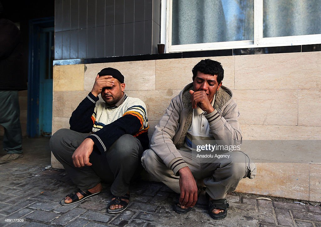 Relatives of Palestinian Ibrahim Mansour, 26, shot dead in the head by Israeli forces, mourn outside a local hospital in Gaza City, on February 13, 2014. A Palestinian man died Thursday after Israeli forces stationed near a border fence east of Gaza City opened fire on a group of Palestinian workers, a Palestinian official said.