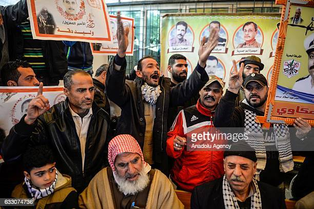 Relatives of Palestinian prisoners stage a demonstration in support of their relatives held in Israeli prisons in front of the International Red...