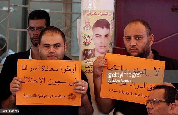 Relatives of Palestinians imprisoned in Israeli jails hold banners and posters during a demonstration demanding the release of Israeliheld...
