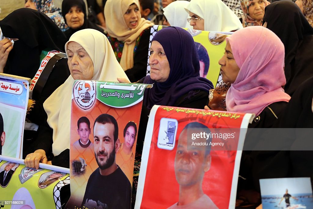 Relatives of Palestinians imprisoned in Israeli jails hold posters during a demonstration demanding the release of Israeli-held Palestinian prisoners in front of the International Committee of the Red Cross office in Gaza City, Gaza on May 2, 2016.
