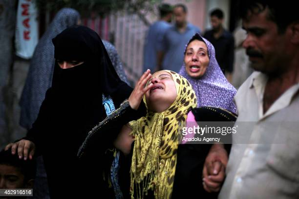Relatives of Palestinians killed in an Israeli strike on a UNrun school mourn in Beit Lahia Gaza on July 30 2014 The death toll from the Israeli...