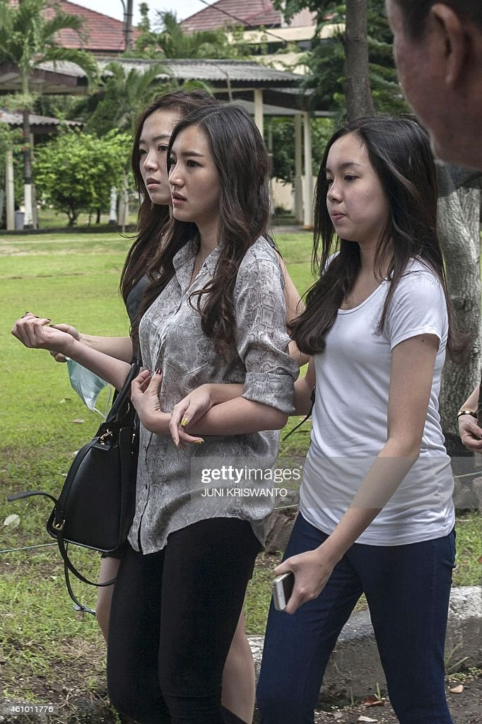 Relatives of passengers of AirAsia flight QZ8501 arrive at a police headquarters to check for new information in Surabaya on January 4 2015 Weather...