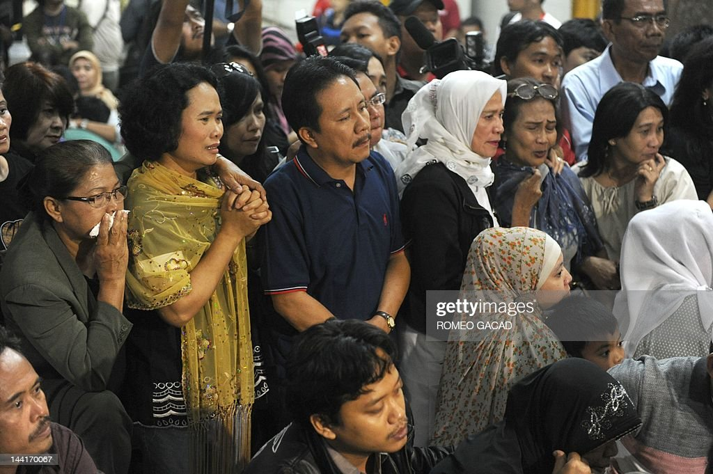 Relatives of passengers of the illfated Russian Sukhoi Superjet 100 gathered at Halim Perdanakusuma airport in Jakarta on May 11 2012 reacts as they...