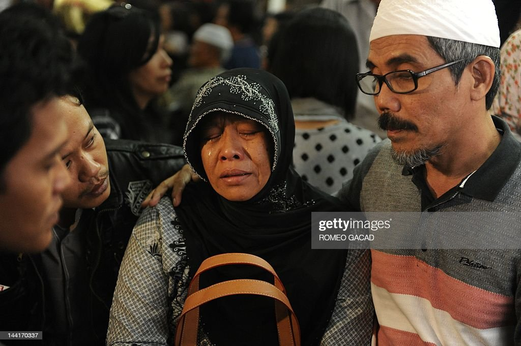 Relatives of passengers of the illfated Russian Sukhoi Superjet 100 gathered at Halim Perdanakusuma airport in Jakarta on May 11 2012 react as they...