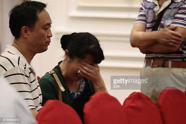 Relatives of passengers on board the Dongfangzhixing or 'Eastern Star' which sank en route from the eastern city of Nanjing to the southwestern city...