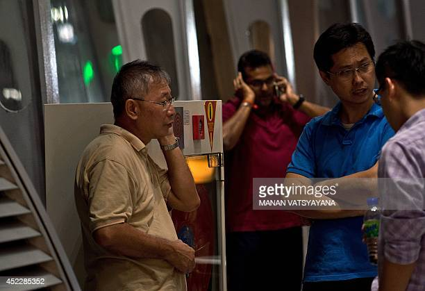Relatives of passengers onboard Malaysia Airlines flight MH17 from Amsterdam wait for information outside the family holding area at the Kuala Lumpur...