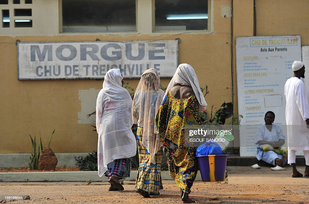 Relatives of people killed in a stampede arrive at the Treichville morgue to retrieve the bodies of the victims in Abidjan, on January 9, 2013. The official death toll rose to 63 two days after a New Year stampede, which broke out among crowds returning from a fireworks display in the economic capital Abidjan.