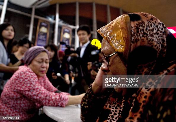 Relatives of people onboard Malaysia Airlines flight MH17 from Amsterdam react outside the family holding area at the Kuala Lumpur International...