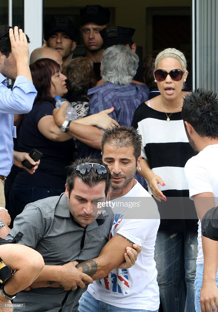 Relatives of people that were sentence to life imprisonment for the mafia-style murder of Cypriot media boss Andis Hadjicostis react after hearing the verdict following the final hearing of the case in the capital of the east Mediterranean island, Nicosia, on June 13, 2013. Television host Elena Skordelli, a 42-year-old mother of two, her brother Tassos Krasopoulis, 37, and Andreas Gregoriou, a 33-year-old meat supplier and plumber Grigoris Xenophontos, 29, were found guilty of the contract killing and sentenced to life imprisonment.