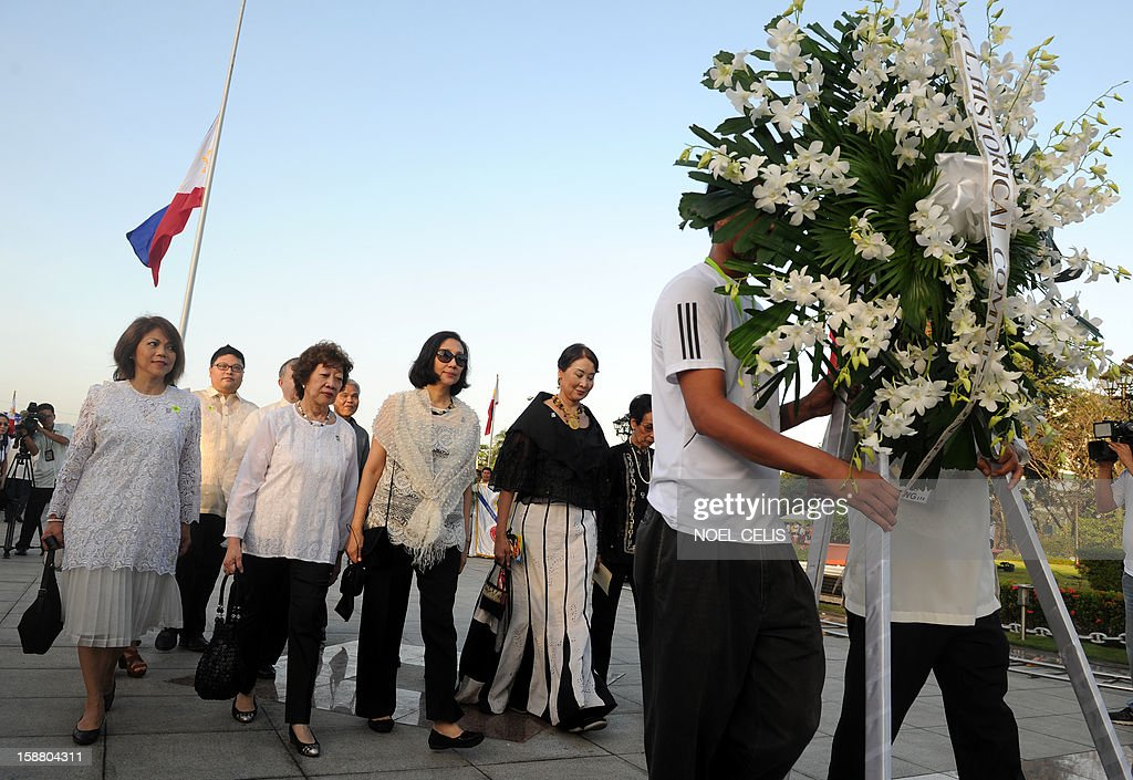 Relatives of Philippine national hero Jose Rizal attend a wreath-laying ceremony on the 106th anniversary of his death at the Luneta Park in Manila on December 30, 2012. Rizal was sentenced to death by a firing squad of the Spanish army after he was accused of leading a revolution against Spain.