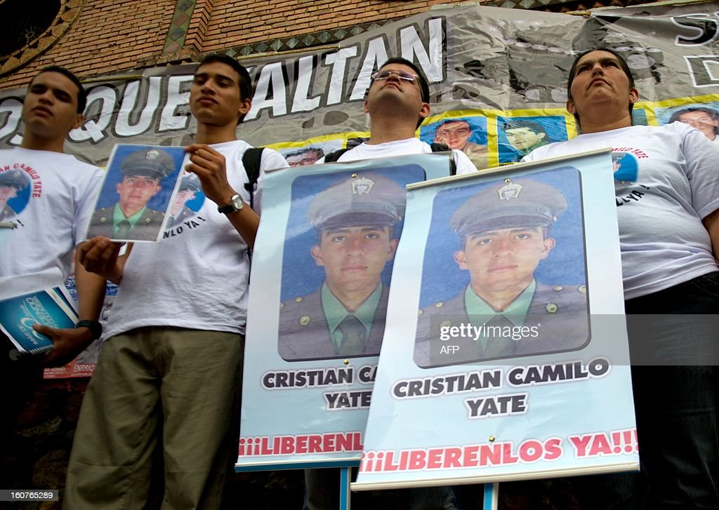 Relatives of police officer Cristian Camilo Yate, kidnapped by the FARC on January 25, demonstrate in Cali, Colombia, on February 5, 2013. Colombia's leftist FARC rebels said Saturday that they will free two captured police officers, Cristian Camilo Yate Sanchez and Victor Alfonso Gonzales Ramirez, and a soldier, Josue Alvarez Meneses, whose abductions had become a source of tension at peace talks with the government and were the first by this rebel group since April 2012 when they freed 10 police and soldiers who had been held captive for years. The FARC said it now is ready to hand their captives over to a delegation from the International Committee of the Red Cross (ICRC) and a nonprofit organization called Colombians for Peace.