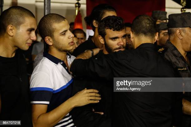 Relatives of police officers who lost their lives during a gun fight mourn during a funeral ceremony held at Police Mosque for Lieutenant Ahmed...