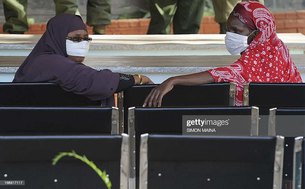 Relatives of policemen who were killed by gunmen wait at the Chiromo Mortuary in Nairobi on November 13, 2012 after 42 policemen were killed on November 10 by gunmen in the country's deadliest ambush in Baragoi, a remote district in Kenya's arid north. The death toll, of officers hunting cattle thieves, has risen to 42 after more bodies were found, police said.
