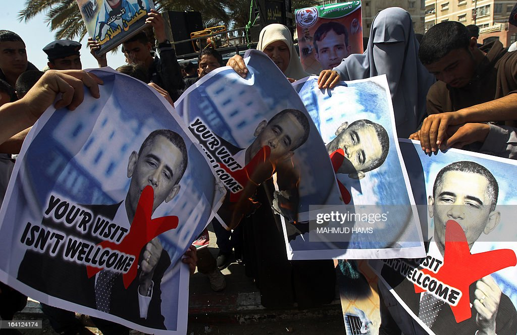 Relatives of prisoners of Palestinians held in Israeli jails burn pictures of US President Barack Obama during a protest against his visit to the region at the Jabalyia refugee camp, in the northern Gaza Strip, on March 20, 2013. Obama is on his way to Israel and the Palestinian Territories for the first time as US president, hoping to ease past tensions with his hosts and under pressure to narrow differences over handling Iran's nuclear threat.