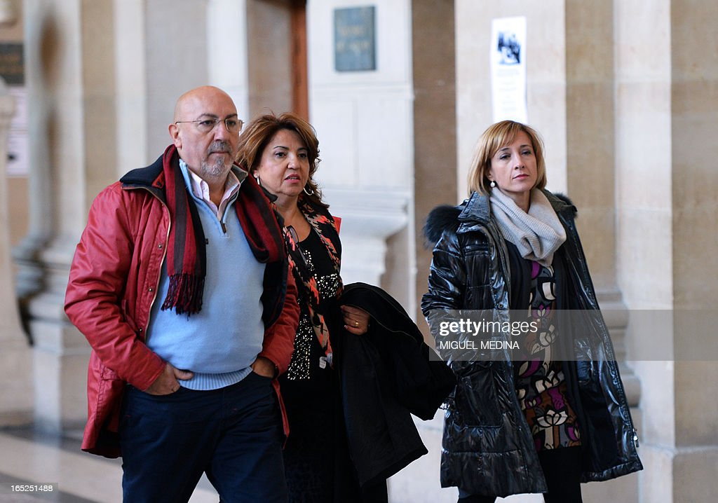Relatives of Raúl Centeno, a Guardia Civil officer who was killed in 2007, walk at Paris' courthouse to attend the trial of three people thought to be members of the Basque separatist group ETA over the killing of Centeno and another Spanish civil guards, on April 2, 2013.