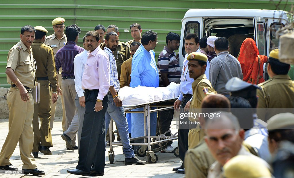 Relatives of Ram Singh, one of the gangrape accused who was found dead in Tihar Jail, with his body after the postmortem at AIIMS in New Delhi on Tuesday.