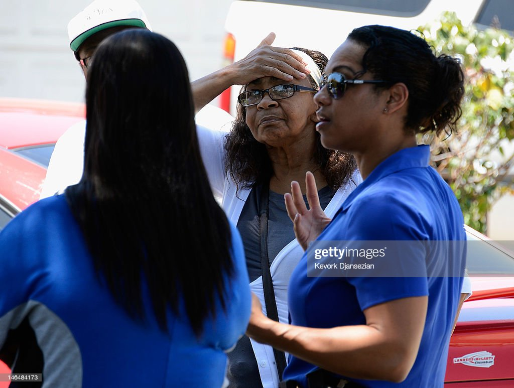 Relatives of Rodney King listen to detective Carla McCulloiugh on June 17, 2012 in Rialto, California. King, whose video beating by Los Angeles police in 1991 sparked riots after the acquittal of the four officers involved, was found dead at the age of 47 from an apparent drowning in his swimming pool.