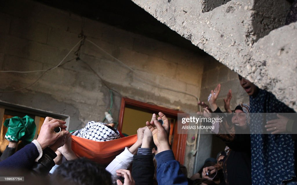 Relatives of Samir Ahmed Awad, 17, mourn his death during a funeral in the West Bank village of Budrus on January 15, 2013. Israeli troops shot dead a Palestinian teenager near the separation barrier in the northern West Bank on Tuesday, Palestinian medical and security sources told AFP. AFP PHOTO/ABBAS MOMANI