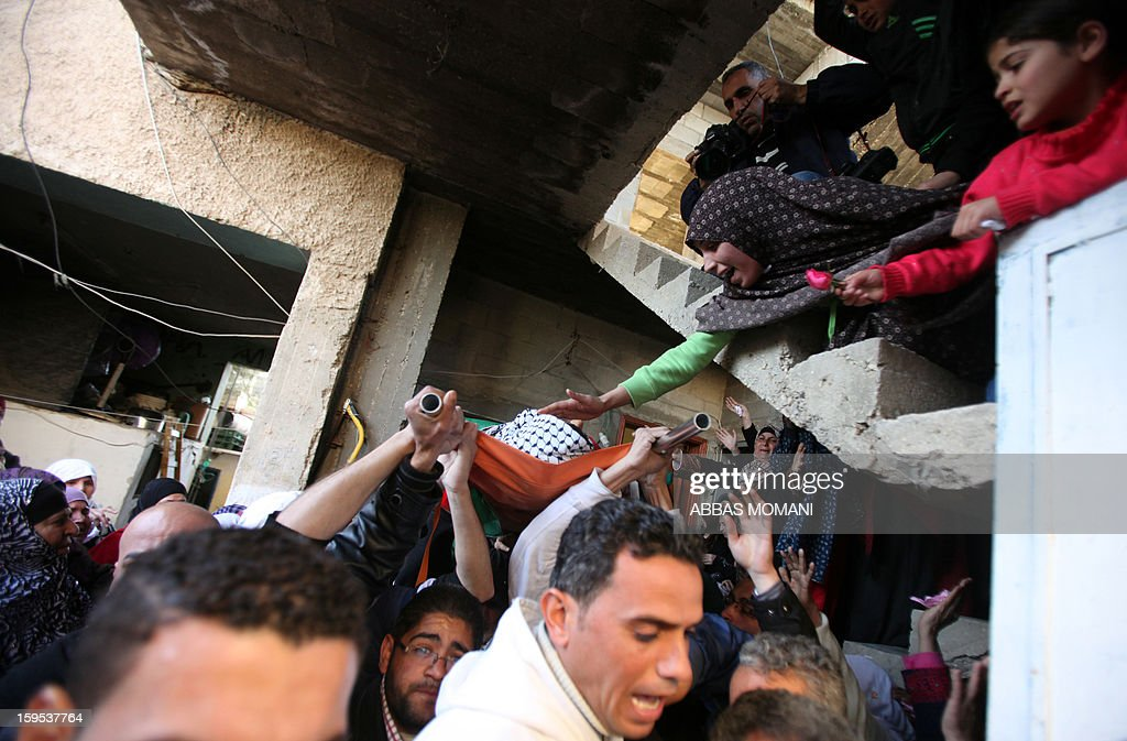 Relatives of Samir Ahmed Awad, 17, mourn his death during a funeral in the West Bank village of Budrus on January 15, 2013. Israeli troops shot dead a Palestinian teenager near the separation barrier in the northern West Bank on Tuesday, Palestinian medical and security sources told AFP.