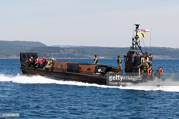 Relatives of soldiers of the Gallipoli campaign are taken ashore by Royal Marines from HMS Bulwark after attending a reception on April 24 2015 in...