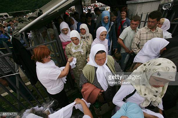 SREBRENICA BOSNIA HERZEGOVINA JULY 11 Relatives of some of the Srebrenica massacre victims arrive to attend the funeral of their family members at...