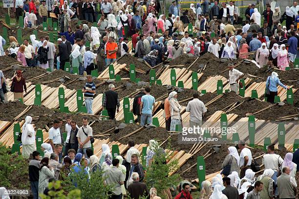 SREBRENICA BOSNIA HERZEGOVINA JULY 11 Relatives of some of the Srebrenica massacre victims attend the funeral of their family members at the...