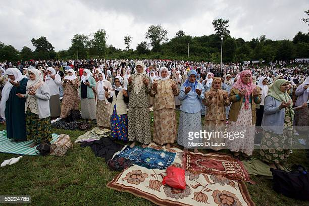 SREBRENICA BOSNIA HERZEGOVINA JULY 11 Relatives of some of the Srebrenica massacre victims pray during the funeral of their family members at the...