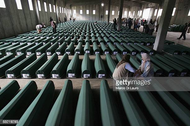 SREBRENICA BOSNIA HERZEGOVINA JULY 9 Relatives of some of the Srebrenica massacre victims pray in front of the 610 coffins containing the remains of...