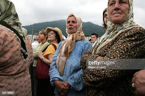 SREBRENICA BOSNIA HERZEGOVINA JULY 9 Relatives of some of the victims of the Srebrenica massacre wait for the remains of their family members to be...