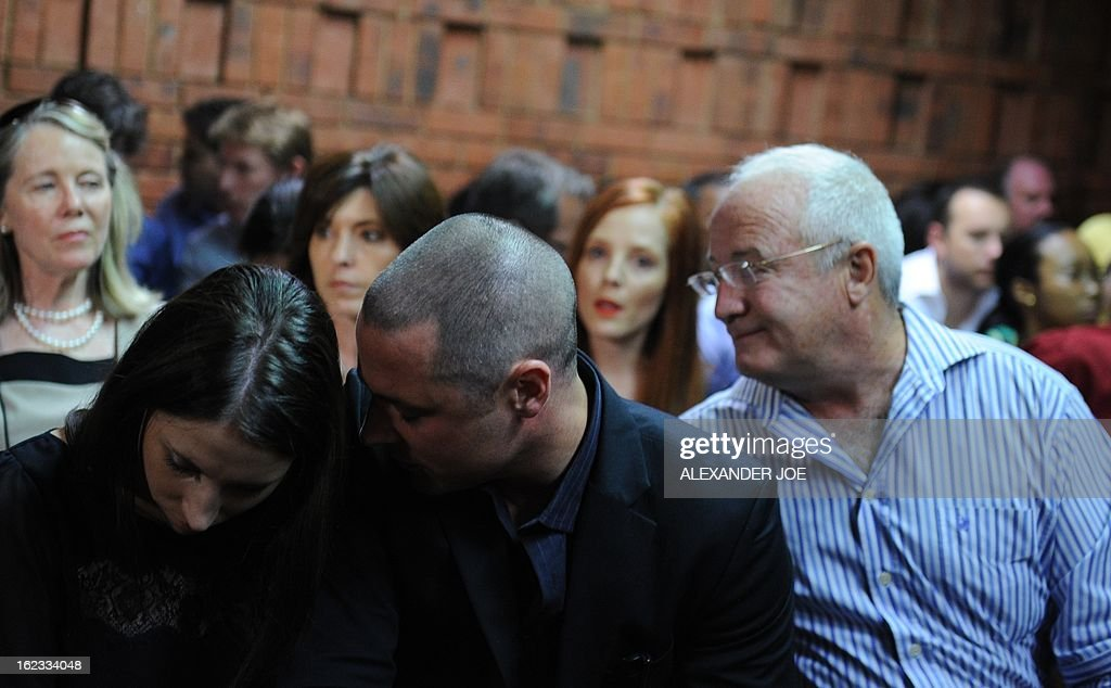 Relatives of South African Olympic sprinter Oscar Pistorius, (From L) his sister Aimee, his brother Carl, and his father Henke appear on February 22, 2013 at the Magistrate Court in Pretoria. Pistorius battled to secure bail as he appeared on charges of murdering his model girlfriend Reeva Steenkamp on February 14, Valentine's Day. South African prosecutors will argue that Pistorius is guilty of premeditated murder in Steenkamp's death, a charge which could carry a life sentence. Pistorius denies the charge, saying that he shot 29-year-old Steenkamp repeatedly through a locked bathroom door in the dead of night by accident, having mistaken her for a burglar.
