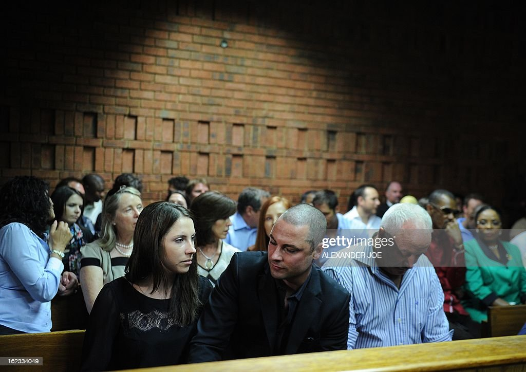 Relatives of South African Olympic sprinter Oscar Pistorius, (From L) his sister Aimee, his brother Carl, and his father Henke appear on February 22, 2013 at the Magistrate Court in Pretoria. Pistorius battled to secure bail as he appeared on charges of murdering his model girlfriend Reeva Steenkamp on February 14, Valentine's Day. South African prosecutors will argue that Pistorius is guilty of premeditated murder in Steenkamp's death, a charge which could carry a life sentence. Pistorius denies the charge, saying that he shot 29-year-old Steenkamp repeatedly through a locked bathroom door in the dead of night by accident, having mistaken her for a burglar. AFP PHOTO / ALEXANDER JOE