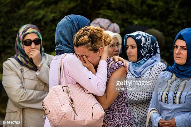 TOPSHOT Relatives of suicide attack victim Mohammad Eymen Demirci mourn on June 29 2016 in Istanbul during his funeral a day after a suicide bombing...