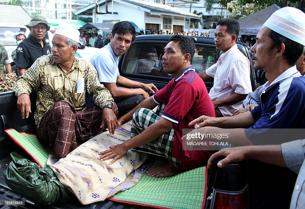 Relatives of suspected insurgents, who were killed when they attacked a military base, move a dead body from a hospital to the funeral ceremony in Thailand's restive southern province of Narathiwat on February 13, 2013. In one of the most deadly attacks in Thailand's long-running insurgency, scores of heavily-armed gunmen stormed a southern army base on February 13, authorities said, leaving 16 militants dead. TOHLALA