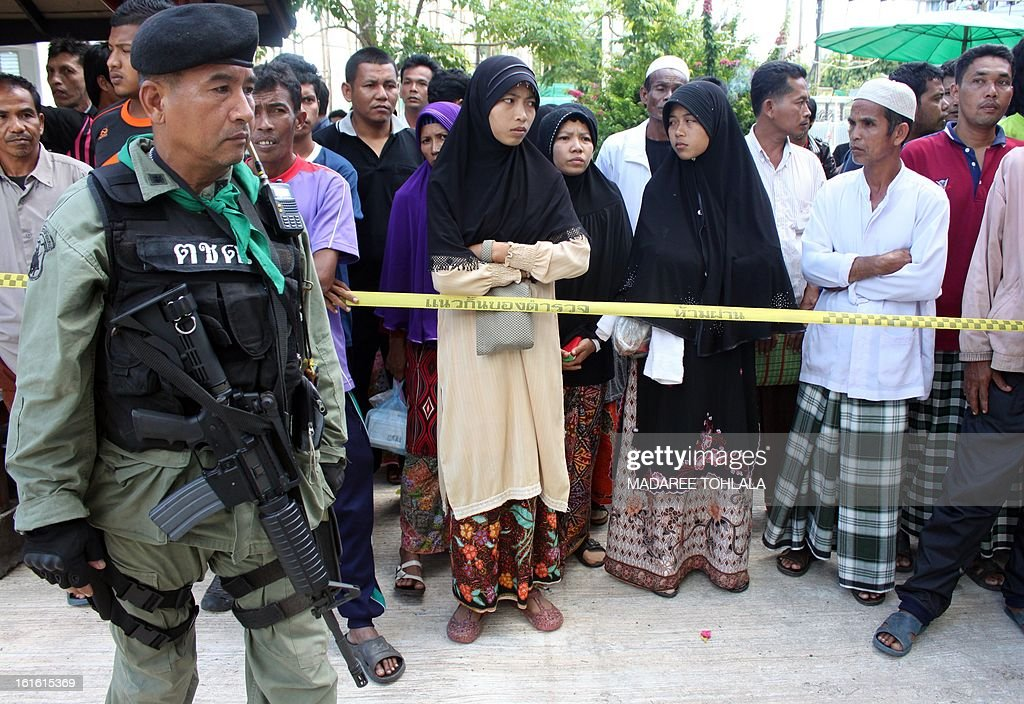 Relatives of suspected insurgents, who were killed when they attacked a military base, wait outside a hospital before the funeral ceremony in Thailand's restive southern province of Narathiwat on February 13, 2013. In one of the most deadly attacks in Thailand's long-running insurgency, scores of heavily-armed gunmen stormed a southern army base on February 13, authorities said, leaving 16 militants dead. TOHLALA