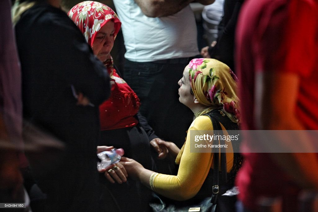 Relatives of the Ataturk Airport suicide bomb attack victims wait outside Bakirkoy Sadi Konuk Hospital, in the early hours of June 29, 2016, in Istanbul, Turkey. Three suicide bombers opened fire before blowing themselves up at the entrance to the main international airport in Istanbul, killing at least 31 people and wounding 147 people according to Justice Minister Bekir Bozdag.