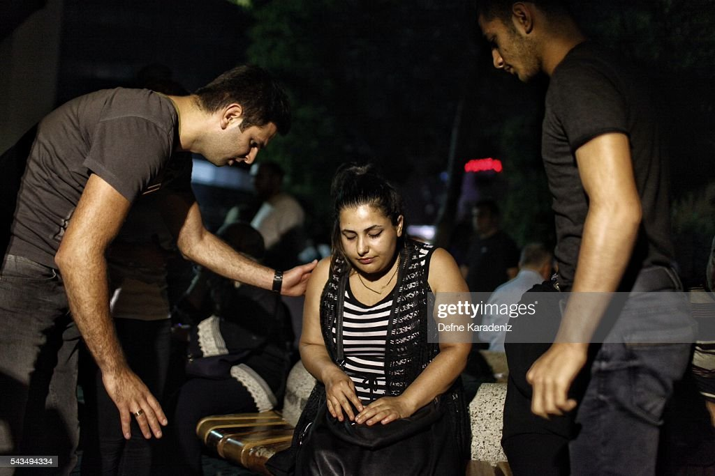 Relatives of the Ataturk Airport suicide bomb attack victims wait outside Bakirkoy Sadi Konuk Hospital, in the early hours of June 29, 2016 in Istanbul, Turkey. Three suicide bombers opened fire before blowing themselves up at the entrance to the main international airport in Istanbul, killing at least 31 people and wounding 147 people according to Justice Minister Bekir Bozdag.