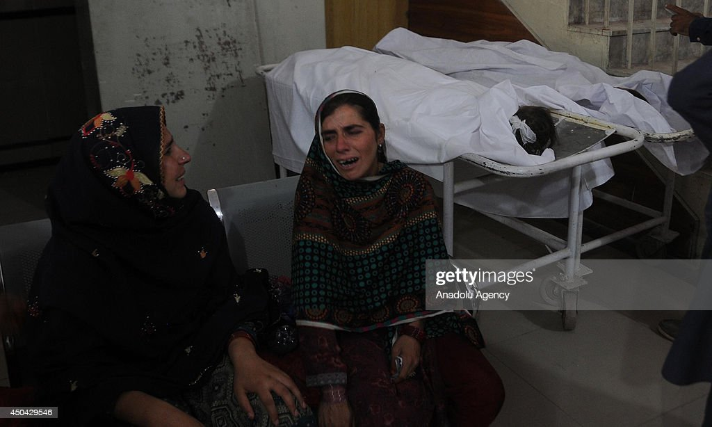 Relatives of the children mourns in Rawalpindi, Pakistan on June 11, 2014. At least five children died and three were injured when a house in Dhoke Lalyal area of Rawalpindi collapsed while they were asleep inside. The injured were shifted to hospital for medical treatment.