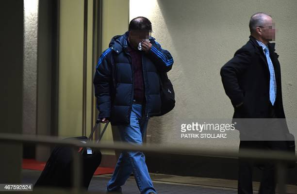 Relatives of the Germanwings plane crash victims arrive to board a Lufthansa plane from the Duesseldorf airport on March 26 2015 in Duesseldorf...