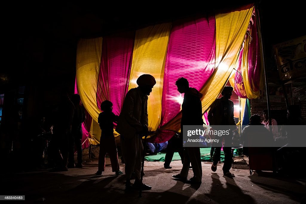Relatives of the groom wait outside a special place prepared for him during a wedding ceremony in the outskirts of New Delhi, India on March 13, 2014. Usually around 500 to 1000 guests wearing traditional clothes, attend the traditional wedding ceremony. The ceremony including traditional foods, music and dance, may differ from religion, culture and region.