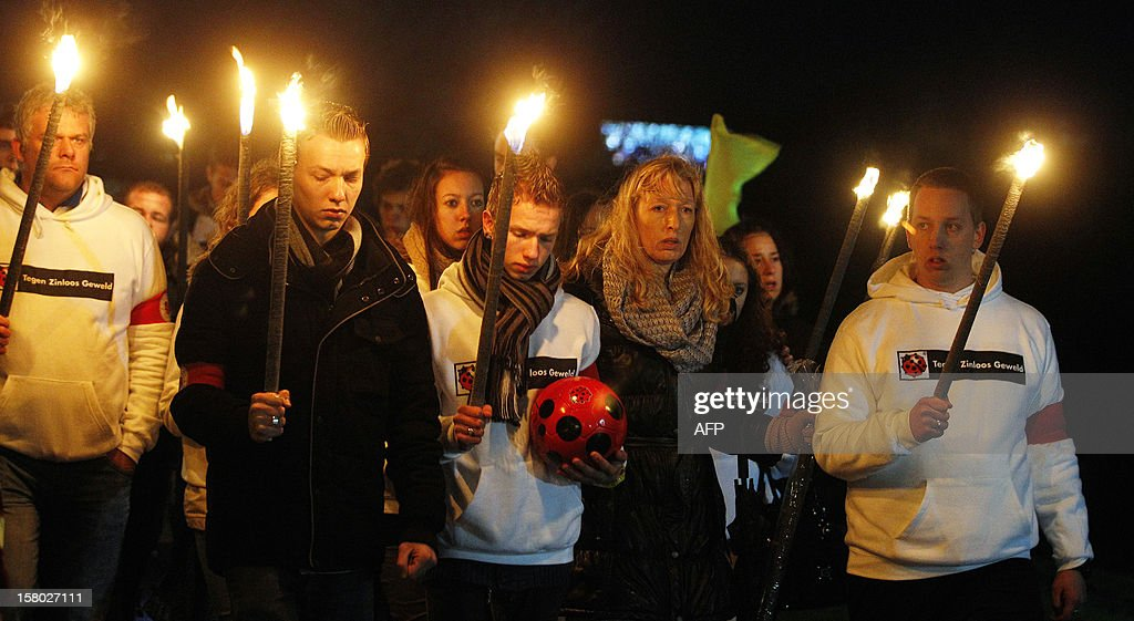 Relatives of the late linesman of the SC Buitenboys football club Richard Nieuwenhuizen take part in a silent march in his memory in Almere on December 9, 2012. Nieuwenhuizen collapsed and fell into a coma after he was attacked by three teenagers at the end of a junior club football match on December 2, 2012. AFP PHOTO / ANP / BAS CZERWINSKI netherlands out
