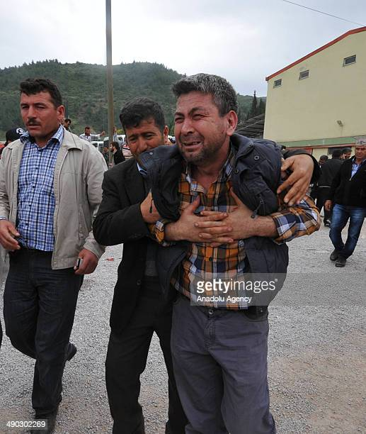 Relatives of the miners killed in the coal mine fire in Soma mourn outside a cold storage house where dead bodies of victims were borught for...