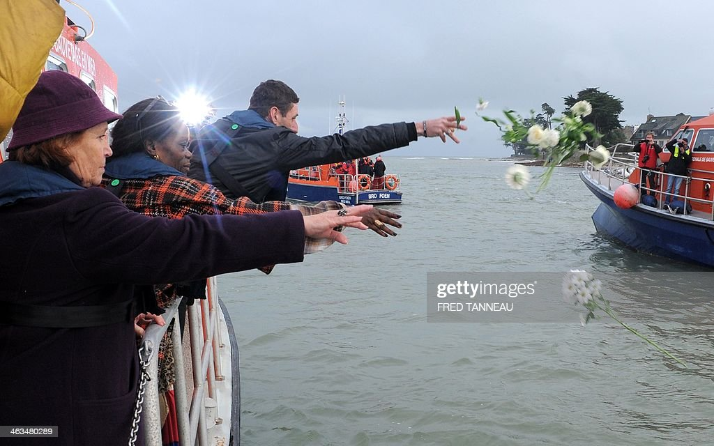 Relatives of the missing sailors of the sunken ship Bugaled Breizh throw flowers into the Atlantic Ocean on January 18, 2014, off the western French coast, near Loctudy in Brittany, to mark the 10th anniversary of the shipwreck. Some 500 people payed hommage to the five missing sailors of the Bulaged Breizh on January 18, 2014 in Loctudy, ten years after the unexplained shipwreck of the Breton trawler off the coast of Great Britain, where were taking place naval military drills.