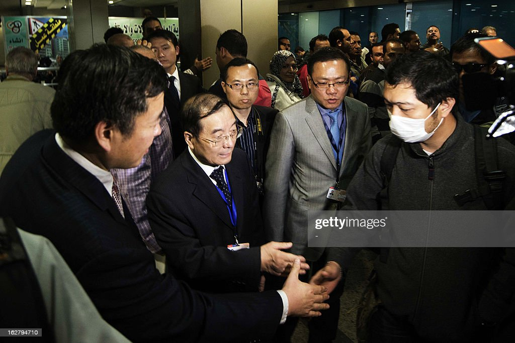 Relatives of the nine Hong Kong citizens, killed in the Luxor balloon accident, are greeted by Chinese Ambassador to Egypt Song Aiguo (C) and Hong Kong immigration officials as they arrive at the Cairo International Airport on February 27, 2013. Four investigating teams were formed after Egypt's Prime Minister Hisham Qandil ordered a probe into the hot air balloon crash on February 26, in the ancient temple city of Luxor, that killed tourists from Hong Kong, Japan, Britain, France and Hungary.