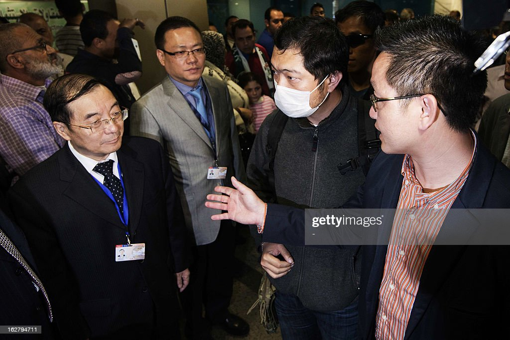 Relatives of the nine Hong Kong citizens, killed in the Luxor balloon accident, speak to Chinese Ambassador to Egypt Song Aiguo (L) and Hong Kong immigration officials as they arrive at the Cairo International Airport on February 27, 2013. Four investigating teams were formed after Egypt's Prime Minister Hisham Qandil ordered a probe into the hot air balloon crash on February 26, in the ancient temple city of Luxor, that killed tourists from Hong Kong, Japan, Britain, France and Hungary. AFP PHOTO/STR