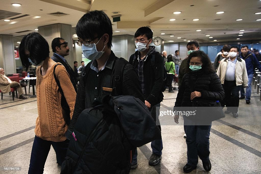 Relatives of the nine Hong Kong citizens, killed in the Luxor balloon accident, arrive at the Cairo International Airport ahead of meeting Chinese Ambassador to Egypt Song Aiguo (C) and Hong Kong immigration officials on February 27, 2013. Four investigating teams were formed after Egypt's Prime Minister Hisham Qandil ordered a probe into the hot air balloon crash on February 26, in the ancient temple city of Luxor, that killed tourists from Hong Kong, Japan, Britain, France and Hungary.