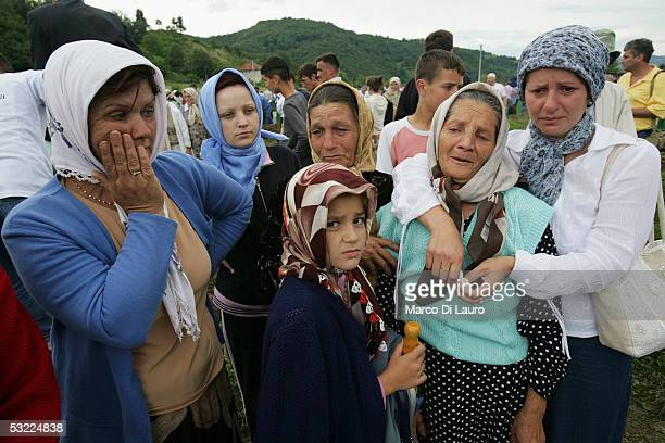 SREBRENICA BOSNIA HERZEGOVINA JULY 11 Relatives of the Srebrenica massacre victims attend the funeral of their family members at the Srebrenica...